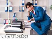 Купить «Young employee making copies at copying machine», фото № 31092305, снято 14 декабря 2018 г. (c) Elnur / Фотобанк Лори