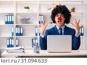 Купить «Young clown businessman working in the office», фото № 31094633, снято 14 декабря 2018 г. (c) Elnur / Фотобанк Лори