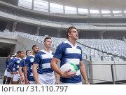 Купить «Diverse rugby players entering stadium in a row for match», фото № 31110797, снято 9 мая 2019 г. (c) Wavebreak Media / Фотобанк Лори