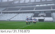 Купить «Group of male rugby players entering stadium in a row for match», фото № 31110873, снято 9 мая 2019 г. (c) Wavebreak Media / Фотобанк Лори