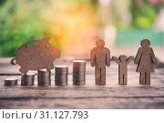 Купить «The coins are stacked and wooden blocks are pig on the wooden floor. - Savings ideas for family», фото № 31127793, снято 18 июля 2018 г. (c) easy Fotostock / Фотобанк Лори
