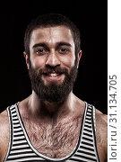 Купить «Emotional portrait of beardy Georgian man with a hairy chest. Closeup studio portrait of beardy guy wearing a striped shirt. affective shot on dark studio background», фото № 31134705, снято 26 февраля 2015 г. (c) easy Fotostock / Фотобанк Лори