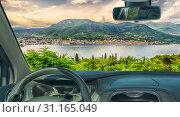 Купить «Looking through a car windshield with view of the town of Salo, on the Lake Garda, Italy», фото № 31165049, снято 28 января 2018 г. (c) easy Fotostock / Фотобанк Лори
