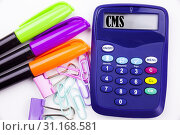Writing word CMS text in the office with surroundings such as marker, pen writing on calculator. Business concept for CMS WWW white background with space. Стоковое фото, фотограф YAY Micro / easy Fotostock / Фотобанк Лори