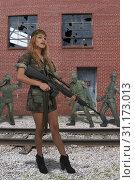 Купить «Beautiful young woman soldier with an assault rifle», фото № 31173013, снято 30 января 2018 г. (c) easy Fotostock / Фотобанк Лори