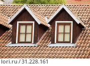 Roof with red tiling and two dormer windows. Стоковое фото, фотограф YAY Micro / easy Fotostock / Фотобанк Лори