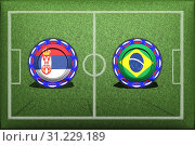 Купить «Football, World Cup 2018, game Group E, Serbia - Brazil, Wednesday, June 27, Button with national flags on the green grass.», фото № 31229189, снято 9 июня 2018 г. (c) easy Fotostock / Фотобанк Лори