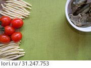 Купить «Top view on handmade macaroni with fresh cherry tomatoes and mushrooms on green background», фото № 31247753, снято 20 января 2018 г. (c) easy Fotostock / Фотобанк Лори