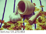 Купить «Wooden mortar filled with Italian pasta with garlic ingredients for preparation», фото № 31273453, снято 22 июня 2018 г. (c) easy Fotostock / Фотобанк Лори