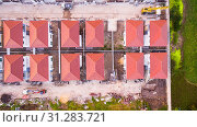 Купить «Top view aerial shot of Housing estate, Shot from drone», фото № 31283721, снято 12 ноября 2016 г. (c) easy Fotostock / Фотобанк Лори