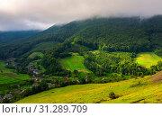Купить «Abranka village in Carpathian mountains. lovely rural scenery on a cloudy sunrise.», фото № 31289709, снято 8 сентября 2017 г. (c) easy Fotostock / Фотобанк Лори