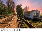 Купить «Gilkey Covered Bridge over Thomas Creek in Scio Oregon during sunset», фото № 31313497, снято 17 октября 2010 г. (c) easy Fotostock / Фотобанк Лори