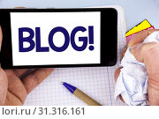 Купить «Handwriting text writing Blog Motivational Call. Concept meaning Preperation of Attractive content for blogging websites written Mobile Phone Screen holding by man plain background Notebook Pen», фото № 31316161, снято 16 марта 2018 г. (c) easy Fotostock / Фотобанк Лори