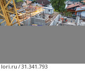 Scena, Italy - July 21, 2016: Elevated view on a construction site with crane in Sankt Georgen / Scena above Merano. Schenna, Italien - Juli 21, 2016:... Стоковое фото, фотограф Zoonar.com/Andy Nowack / age Fotostock / Фотобанк Лори