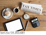 Tax times mock up newspaper with clock, calculator and blank tablet screen. Стоковое фото, фотограф YAY Micro / easy Fotostock / Фотобанк Лори