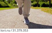 feet of old woman running along summer park road. Стоковое видео, видеограф Syda Productions / Фотобанк Лори