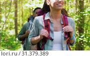 Купить «group of friends with backpacks hiking in forest», видеоролик № 31379389, снято 29 июня 2019 г. (c) Syda Productions / Фотобанк Лори