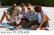Купить «friends with tablet pc on wooden terrace in summer», видеоролик № 31379429, снято 29 июня 2019 г. (c) Syda Productions / Фотобанк Лори
