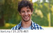 Купить «outdoor portrait of smiling man in summer», видеоролик № 31379461, снято 29 июня 2019 г. (c) Syda Productions / Фотобанк Лори