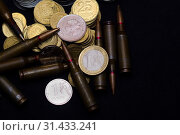 Купить «One euro, Russian ruble and small Ukrainian coins with rifle military ammo on black background. Symbolizes war for money- biggest problem in world.», фото № 31433241, снято 19 августа 2018 г. (c) easy Fotostock / Фотобанк Лори