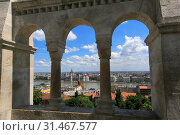 Купить «Beautiful view of the city and the Hungarian parliament building through the wall and arches of the Fisherman's Bastion on a sunny summer day in Budapest, Hungary», фото № 31467577, снято 3 июня 2019 г. (c) Яна Королёва / Фотобанк Лори