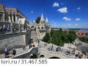 Купить «Hungary, Budapest, June 3, 2019. Tourists visiting one of the sights of Budapest - Fishermen's Bastion», фото № 31467585, снято 3 июня 2019 г. (c) Яна Королёва / Фотобанк Лори
