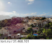 Aerial photo drone point of view image Campanet town hillside residential old ancient houses building exterior situated in the northeast of Majorca Island, Spain (2019 год). Стоковое фото, фотограф Alexander Tihonovs / Фотобанк Лори