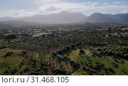 Aerial photo Campanet town situated in the northeast of Palma de Majorca, agricultural fields and meadows countryside rural scene, Balearic Islands, Spain (2019 год). Стоковое фото, фотограф Alexander Tihonovs / Фотобанк Лори