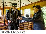 Купить «Inspector and traveller, Llanfair and Welshpool Steam Railway, Wales.», фото № 31470829, снято 4 апреля 2020 г. (c) age Fotostock / Фотобанк Лори