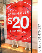 Купить «Store banner in shopfront advertises a sale with nothing over $20.00», фото № 31476397, снято 27 декабря 2017 г. (c) easy Fotostock / Фотобанк Лори