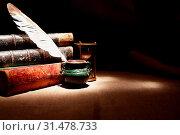 Купить «Vintage still life. Quill pen near old books on dark background», фото № 31478733, снято 10 января 2018 г. (c) easy Fotostock / Фотобанк Лори
