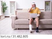 Купить «Young man after accident recovering at home», фото № 31482805, снято 3 мая 2019 г. (c) Elnur / Фотобанк Лори