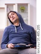 Купить «Young man having problems with narcotics at home», фото № 31485205, снято 25 апреля 2019 г. (c) Elnur / Фотобанк Лори