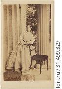 Woman standing, leaning on chair back, J.G. & E.G. Short (British), 1865 - 1875, Albumen silver print (2018 год). Редакционное фото, фотограф © Liszt Collection / age Fotostock / Фотобанк Лори