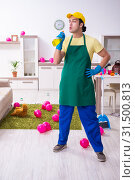 Купить «Young male contractor doing housework after party», фото № 31500813, снято 14 марта 2019 г. (c) Elnur / Фотобанк Лори