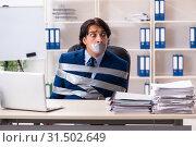 Купить «Young tied male employee in the office», фото № 31502649, снято 18 декабря 2018 г. (c) Elnur / Фотобанк Лори