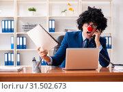 Купить «Young clown businessman working in the office», фото № 31502673, снято 14 декабря 2018 г. (c) Elnur / Фотобанк Лори