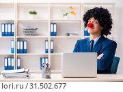 Купить «Young clown businessman working in the office», фото № 31502677, снято 14 декабря 2018 г. (c) Elnur / Фотобанк Лори