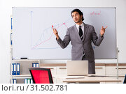 Купить «Young handsome businessman in front of whiteboard», фото № 31502781, снято 10 октября 2018 г. (c) Elnur / Фотобанк Лори