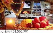 Зимний вечер у камина с бокалом вина и фруктами. Стоковое видео, видеограф Виктор Топорков / Фотобанк Лори