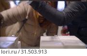 Купить «Pretty woman try flavors, give it to her friend, perfume department of a store», видеоролик № 31503913, снято 2 июля 2019 г. (c) Ирина Мойсеева / Фотобанк Лори