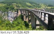 Купить «Plevlya, Montenegro - June 11. 2019. Dzhurdzhevich bridge over the river Tara», видеоролик № 31526429, снято 25 июня 2019 г. (c) Володина Ольга / Фотобанк Лори