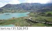 Купить «Panoramic view over Embalse de Zahara inland lake, Andalusia, Spain», видеоролик № 31526913, снято 18 апреля 2019 г. (c) Яков Филимонов / Фотобанк Лори