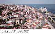 Купить «Aerial view of old center of Lisbon with Santa Maria Maior (or Se Cathedral), Portugal», видеоролик № 31526921, снято 20 апреля 2019 г. (c) Яков Филимонов / Фотобанк Лори