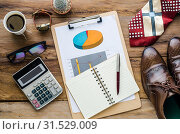 Купить «Costume calculator, pen, notebook and accessory for work on wooden table.», фото № 31529009, снято 11 марта 2016 г. (c) easy Fotostock / Фотобанк Лори