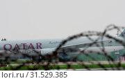 Купить «Cargo airplane taxiing after landing», видеоролик № 31529385, снято 4 мая 2019 г. (c) Игорь Жоров / Фотобанк Лори