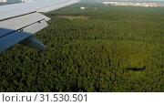 Купить «Aerial view from descending airplane», видеоролик № 31530501, снято 13 июля 2019 г. (c) Игорь Жоров / Фотобанк Лори