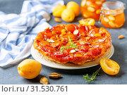 Купить «Apricot tarte tatin pie with thyme and almonds», фото № 31530761, снято 10 июля 2019 г. (c) Марина Сапрунова / Фотобанк Лори