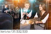 Купить «Emotional portrait of two women holding laser pistols and playin», фото № 31532533, снято 4 апреля 2019 г. (c) Яков Филимонов / Фотобанк Лори