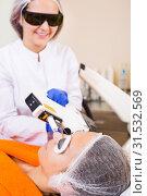 Купить «Female client doing laser hair removal from face», фото № 31532569, снято 19 августа 2019 г. (c) Яков Филимонов / Фотобанк Лори